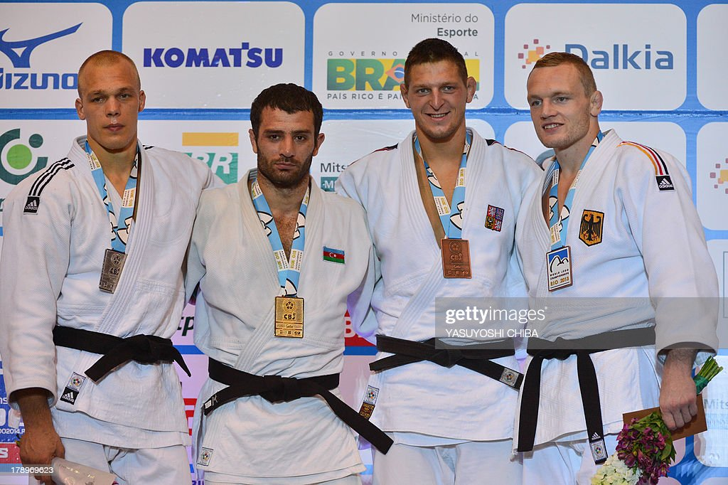 Gold medalist Azerbaijan's Elkhan Mammadov (2nd L), Silver medalist Netherlands' Henk Grol (L), Bronze medalists Germany's Dimitri Peters (R) and Czech's Lukas Krpalek pose during the medal ceremony for the -100kg category, during the IJF World Judo Championship, in Rio de Janeiro, Brazil, on August 31, 2013. AFP PHOTO / YASUYOSHI CHIBA