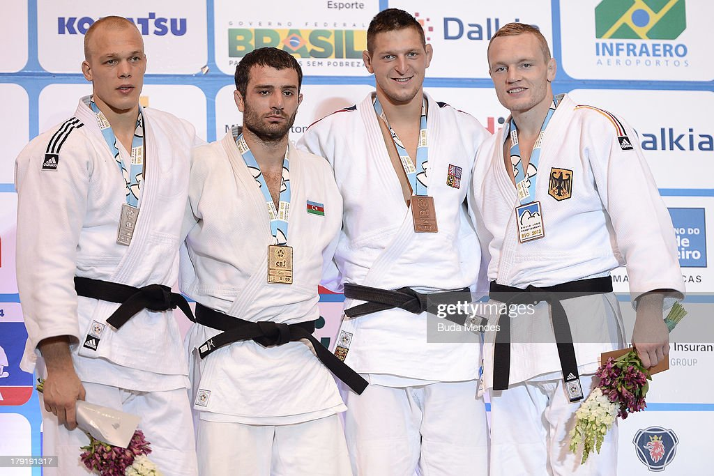 Gold medalist Azerbaijan's Elkhan Mammadov (2nd L), Silver medalist Netherlands' Henk Grol (L), Bronze medalists Germany's Dimitri Peters (R) and Czech's Lukas Krpalek pose during the medal ceremony for the -100kg category, during the IJF World Judo Championship at Gymnasium Maracanazinho on August 31, 2013 in Rio de Janeiro, Brazil.