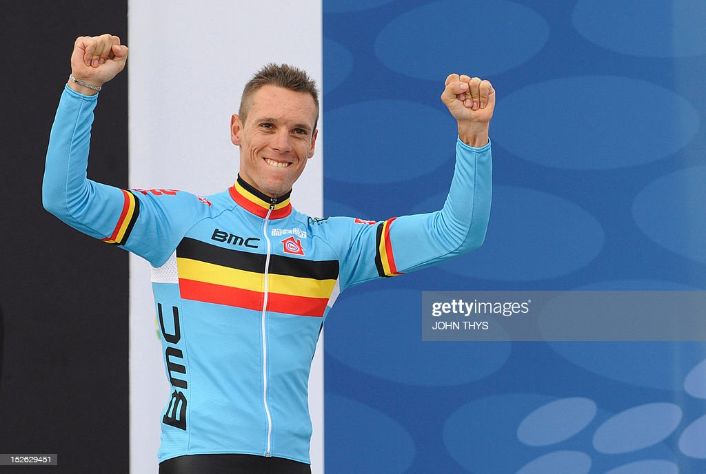 Gold medalist Belgium's Philippe Gilbert celebrates on the podium at the end of the Men's Elite Race at the UCI Road World Championships on September 23, 2012 in Valkenburg. Philippe Gilbert of Belgium won the race ahead of second placed Edvald Boasson Hagen of Norway and third placed Alejandro Valverde of Spain. AFP PHOTO/JOHN THYS