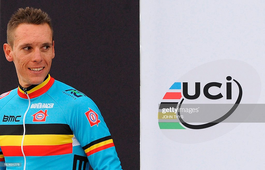 Gold medalist Belgium's Philippe Gilbert reacts on the podium at the end of the Men's Elite Race at the UCI Road World Championships on September 23, 2012 in Valkenburg. Philippe Gilbert of Belgium won the race ahead of second placed Edvald Boasson Hagen of Norway and third placed Alejandro Valverde of Spain.