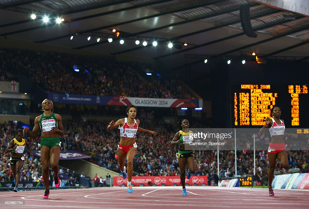 Gold medalist <a gi-track='captionPersonalityLinkClicked' href=/galleries/search?phrase=Blessing+Okagbare&family=editorial&specificpeople=5496695 ng-click='$event.stopPropagation()'>Blessing Okagbare</a> of Nigeria, Silver medalist <a gi-track='captionPersonalityLinkClicked' href=/galleries/search?phrase=Jodie+Williams+-+Sprinter&family=editorial&specificpeople=5964402 ng-click='$event.stopPropagation()'>Jodie Williams</a> of England, <a gi-track='captionPersonalityLinkClicked' href=/galleries/search?phrase=Schillonie+Calvert&family=editorial&specificpeople=2133069 ng-click='$event.stopPropagation()'>Schillonie Calvert</a> of Jamaica and Bronze medalist <a gi-track='captionPersonalityLinkClicked' href=/galleries/search?phrase=Bianca+Williams&family=editorial&specificpeople=5970051 ng-click='$event.stopPropagation()'>Bianca Williams</a> of England cross the finish line the Women's 200m Final at Hampden Park during day eight of the Glasgow 2014 Commonwealth Games on July 31, 2014 in Glasgow, United Kingdom.