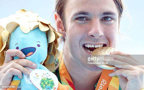 Gold medalist Brayden Davidson of Australia celebrates on the podium at the medal ceremony for the Men's Long Jump T36 heat two at Olympic Stadium...