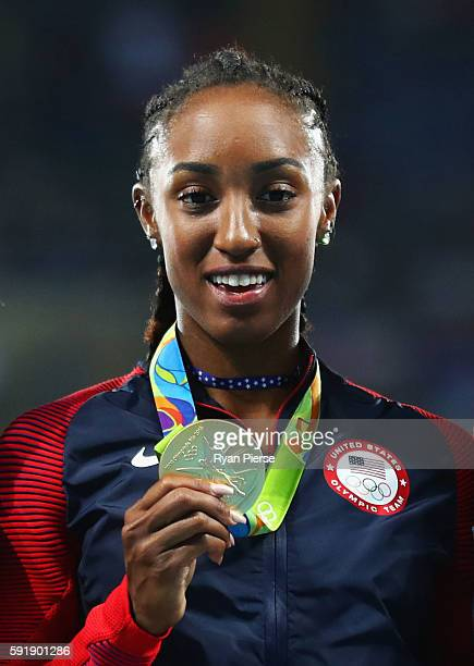 Gold medalist Brianna Rollins of the United States poses on the podium during the medal ceremony for the Women's 100m Hurdles on Day 13 of the Rio...