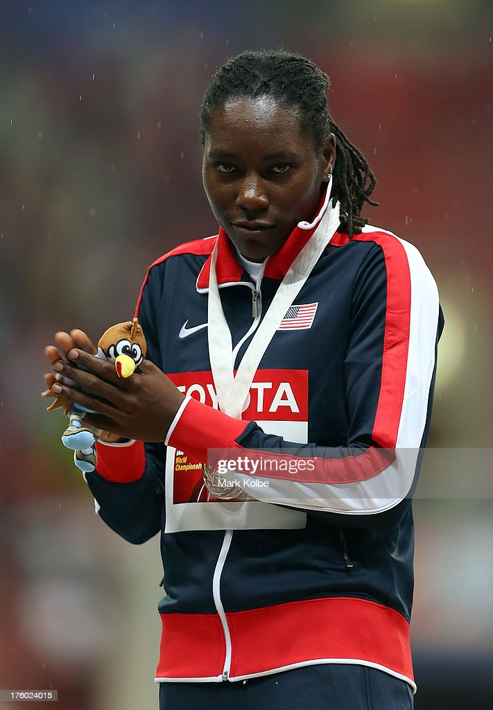 Gold medalist <a gi-track='captionPersonalityLinkClicked' href=/galleries/search?phrase=Brittney+Reese&family=editorial&specificpeople=4362432 ng-click='$event.stopPropagation()'>Brittney Reese</a> of the United States on the podium during the medal ceremony for the Women's Long Jump final during Day Two of the 14th IAAF World Athletics Championships Moscow 2013 at Luzhniki Stadium on August 11, 2013 in Moscow, Russia.