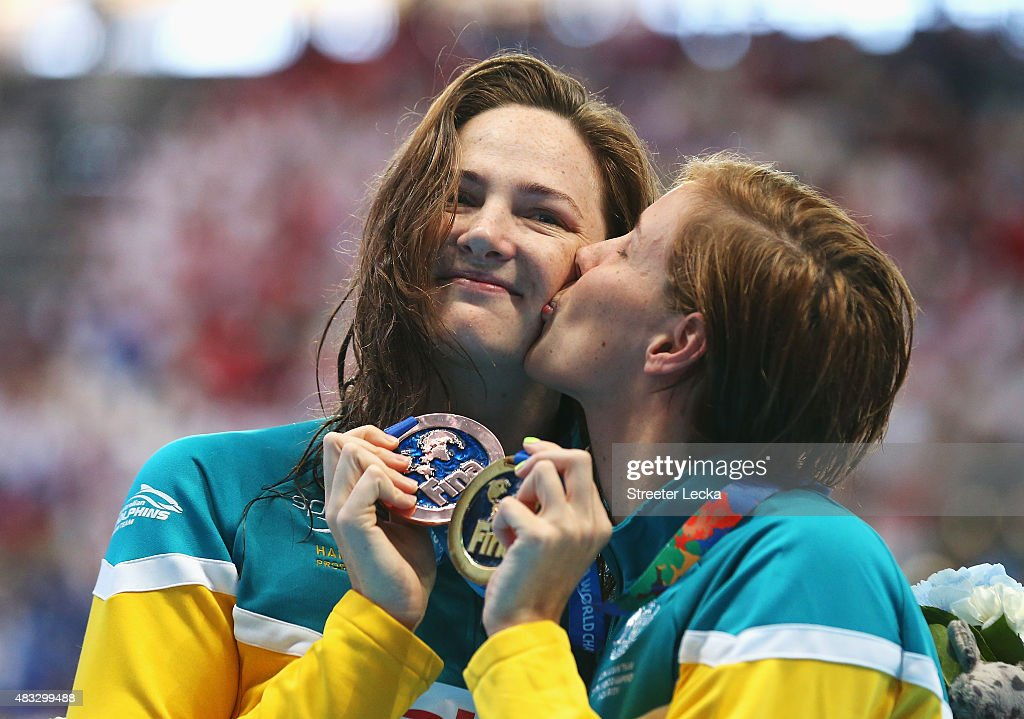 Gold medalist Bronte Campbell of Australia kisses her sister and bronze medalist Cate during the medal ceremony for the Women's 100m Freestyle on day...