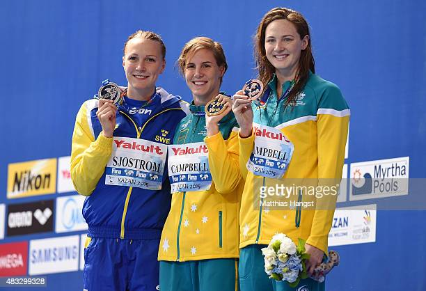 Gold medalist Bronte Campbell of Australia poses with silver medalist Sarah Sjostrom of Sweden and bronze medalist Cate Campbell of Australia during...