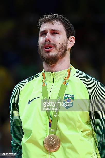 Gold medalist Bruno Rezende of Brazil celebrates during the medal ceremony after the Men's Gold Medal Match between Italy and Brazil on Day 16 of the...