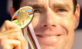 Gold medalist Cadel Evans of Australia shows his medal on the podium of the Elite men's world road race championships at Mendrisio on September 27...