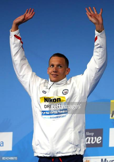 Gold medalist Caeleb Remel Dressel of the United States celebrates during the medal ceremony for the Men's 50m Freestyle final on day sixteen of the...