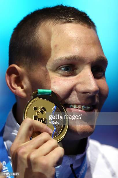 Gold medalist Caeleb Remel Dressel of the United States poses with the medal won during the Men's 100m Freestyle final on day fourteen of the...
