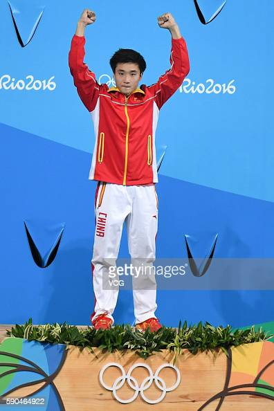 Gold medalist Cao Yuan of China poses during the medal ceremony for the Men's Diving 3m Springboard final at the Maria Lenk Aquatics Centre on August...