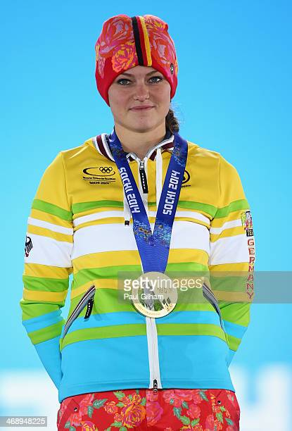 Gold medalist Carina Vogt of Germany celebrates during the medal ceremony for the Ladies' Normal Hill Individual on day five of the Sochi 2014 Winter...
