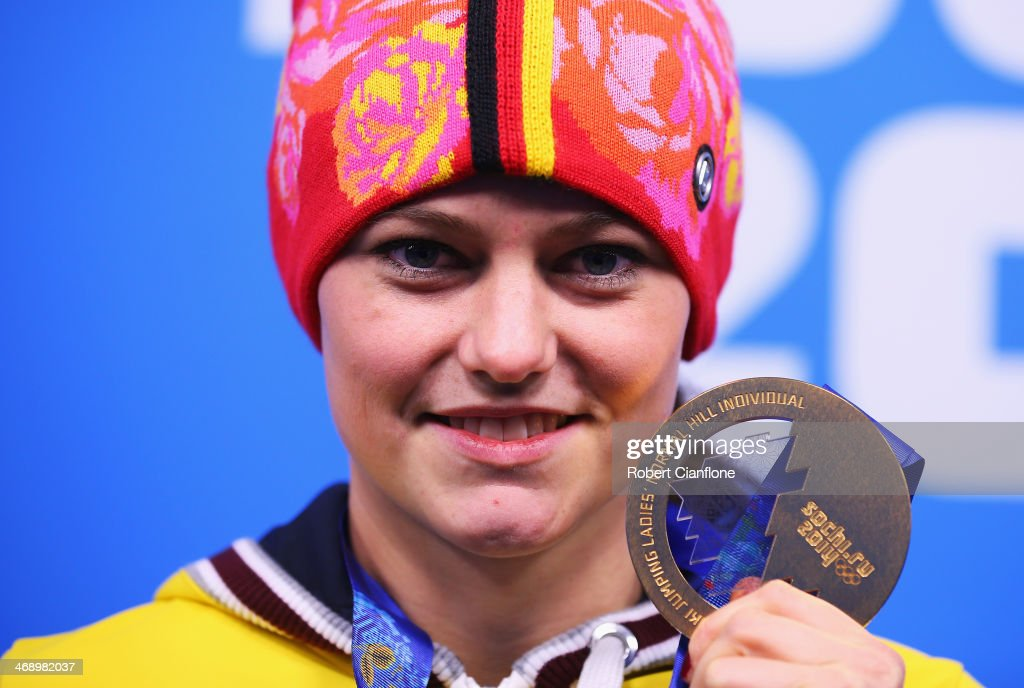 Gold medalist <a gi-track='captionPersonalityLinkClicked' href=/galleries/search?phrase=Carina+Vogt&family=editorial&specificpeople=4596006 ng-click='$event.stopPropagation()'>Carina Vogt</a> of Germany celebrates during the medal ceremony for the Ladies' Normal Hill Individual on day five of the Sochi 2014 Winter Olympics at Medals Plaza on February 12, 2014 in Sochi, Russia.