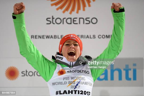 Gold medalist Carina Vogt of Germany celebrates following the Women's Ski Jumping HS100 during the FIS Nordic World Ski Championships on February 24...
