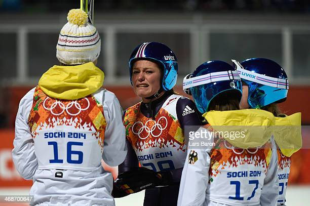 Gold medalist Carina Vogt of Germany celebrates winning the gold medal with Ulrike Graessler Gianina Ernst and Katharina Althaus of Germany after the...