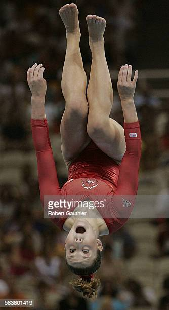 Gold medalist Carly Patterson of the USA keeps her eyes on the balance beam as she flips her way to a score of 9725 at the Women's Individual All...