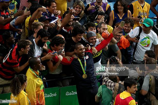 Gold medalist Carmelo Anthony of the United States celebrates with the crowd following the Men's Gold medal game on Day 16 of the Rio 2016 Olympic...