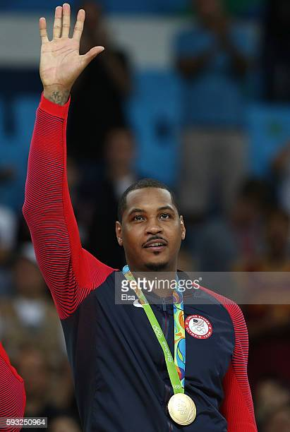 Gold medalist Carmelo Anthony of the United States reacts on the podium after defeating Serbia in the Men's Gold medal game on Day 16 of the Rio 2016...