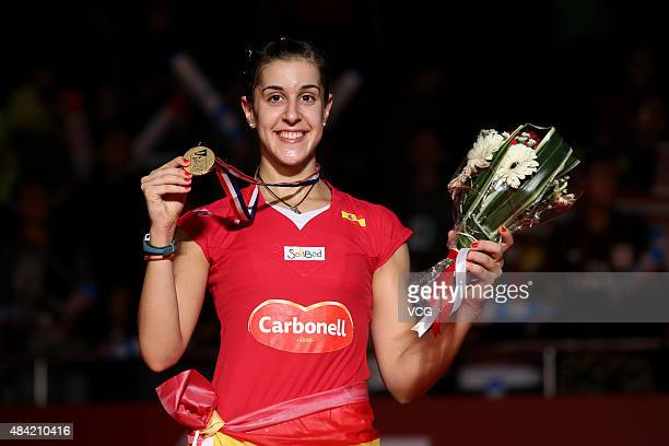 Gold medalist Carolina Marin of Spain celebrates on the podium after the Women's Singles final match of the 2015 Total BWF World Championship at...