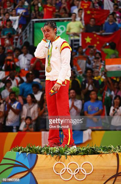 Gold medalist Carolina Marin of Spain reacts during the medal ceremony after the Women's Singles Badminton competition on Day 14 of the Rio 2016...