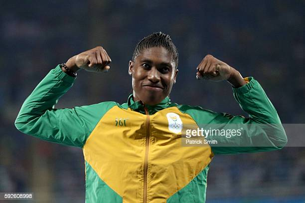 Gold medalist Caster Semenya of South Africa stands on the podium during the medal ceremony for the Women's 800 meter on Day 15 of the Rio 2016...
