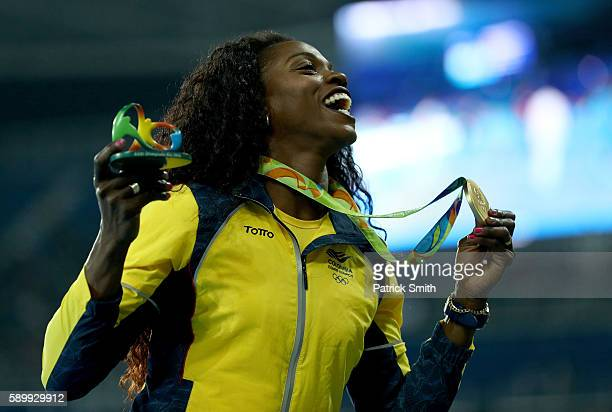 Gold medalist Caterine Ibarguen of Colombia celebrates on the podium during the medal ceremony for the Women's Triple Jump on Day 10 of the Rio 2016...