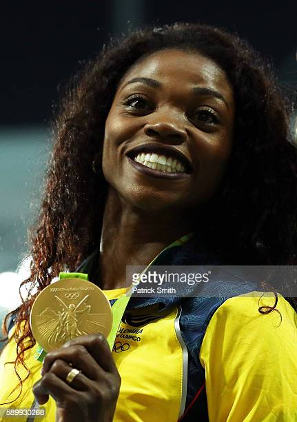 Gold medalist Caterine Ibarguen of Colombia reacts on the podium during the medal ceremony for the Women's Triple Jump on Day 10 of the Rio 2016...