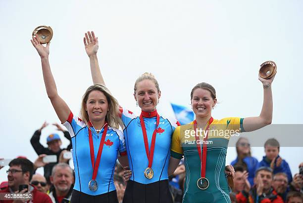 Gold Medalist Catharine Pendrel of Canada Silver Medalist Emily Batty of Canada and Bronze Medalist Rebecca Henderson of Australia celebrate with...