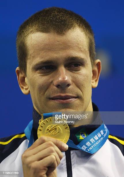 Gold medalist Cesar Cielo Filho of Brazil is overcome with emotion on the podium during the medal ceremony for the Men's 50m Butterfly final during...