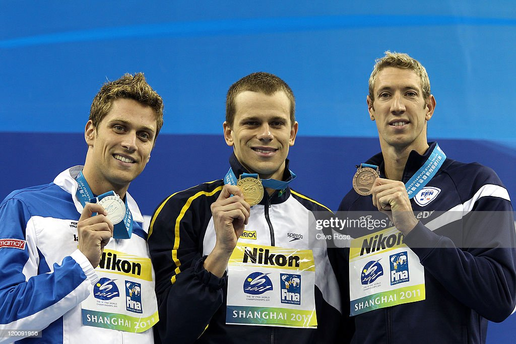 Gold medalist Cesar Cielo Filho (C) of Brazil poses with silver medalist Luca Dotto of Italy and bronze medalist Alain Bernard of France after the Men's 50m Freestyle Final during Day Fifteen of the 14th FINA World Championships at the Oriental Sports Center on July 30, 2011 in Shanghai, China.