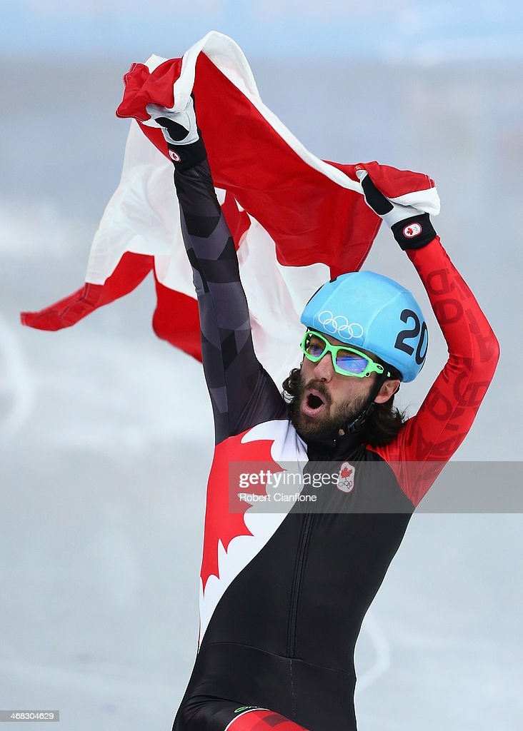 Gold medalist <a gi-track='captionPersonalityLinkClicked' href=/galleries/search?phrase=Charles+Hamelin&family=editorial&specificpeople=820316 ng-click='$event.stopPropagation()'>Charles Hamelin</a> of Canada celebrates after wiining the Short Track Men's 1500m Final on day 3 of the Sochi 2014 Winter Olympics at Iceberg Skating Palace on February 10, 2014 in Sochi, Russia.