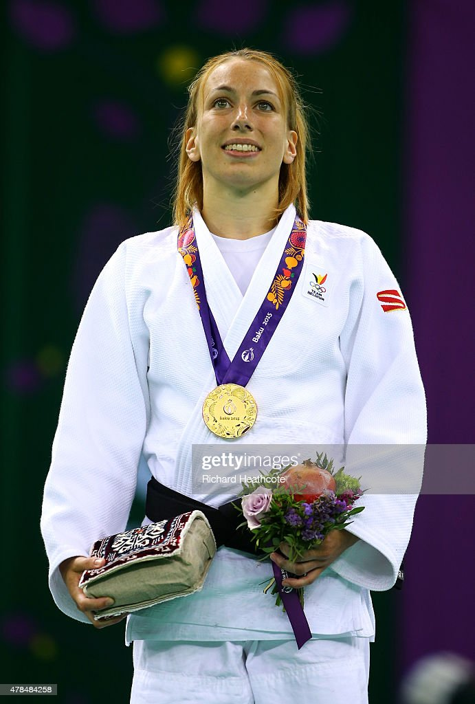 Gold medalist Charline van Snick of Belgium poses on the medal podium following the Women's Judo -48kg Finals during day thirteen of the Baku 2015 European Games at the Heydar Aliyev Arena on June 25, 2015 in Baku, Azerbaijan.