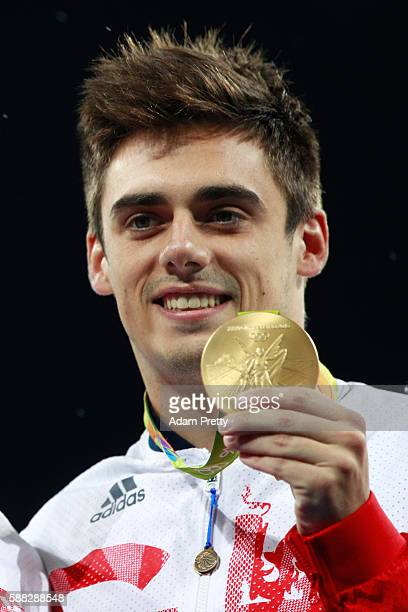 Gold medalist Chris Mears of Great Britain poses during the medal ceremony for the Men's Diving Synchronised 3m Springboard Final on Day 5 of the Rio...