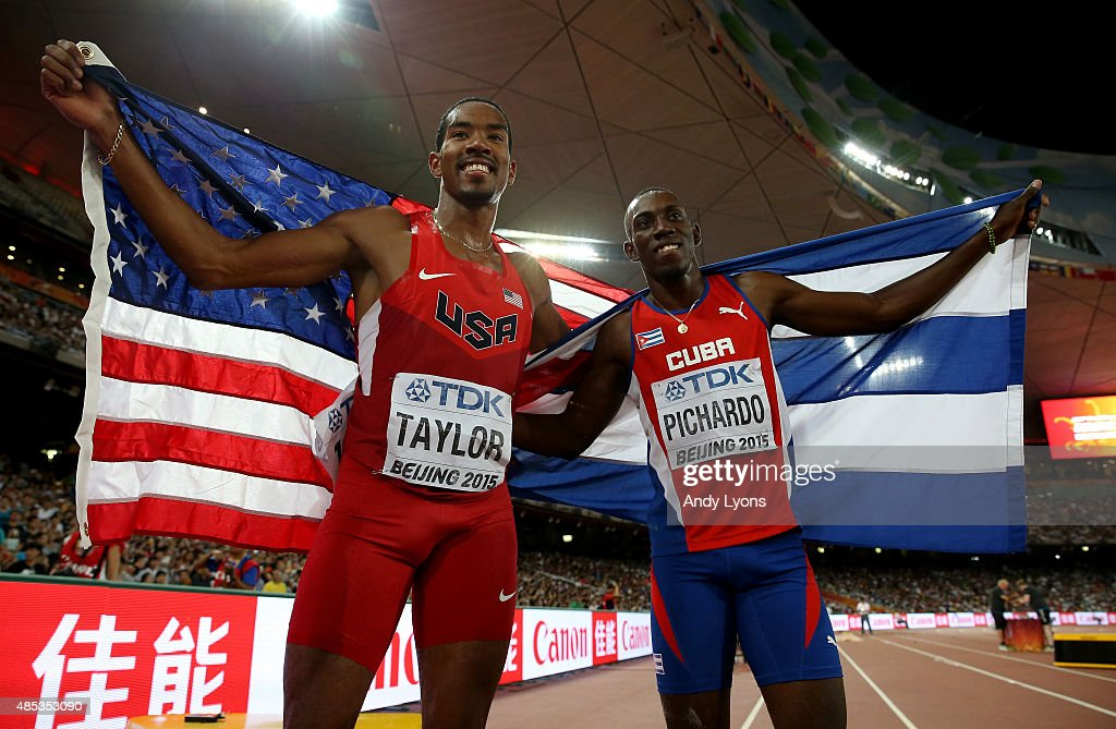 http://media.gettyimages.com/photos/gold-medalist-christian-taylor-of-the-united-states-and-silver-pedro-picture-id485353090