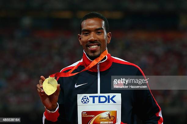 Gold medalist Christian Taylor of the United States poses on the podium during the medal ceremony for the Men's Triple Jump final during day seven of...