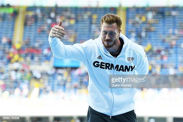 Gold medalist Christoph Harting of Germany celebrates on the podium during the medal ceremony for the Men's Discus Throw Final on Day 8 of the Rio...