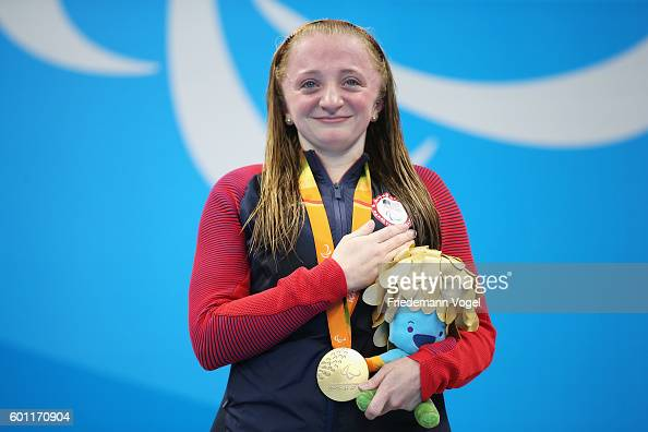 Gold medalist Coan McKenzie of the United States celebrates on the podium at the medal ceremony for the Women's 50m Freestyle S7 Final on day 2 of...