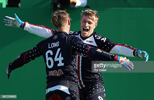 Gold medalist Connor Fields celebrates with teammate Nicholas Long of the United States during the Men's BMX Final on day 14 of the Rio 2016 Olympic...