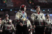 Gold medalist curling skip Kevin Martin of Canada walks with his team during the Closing Ceremony of the Vancouver 2010 Winter Olympics at BC Place...