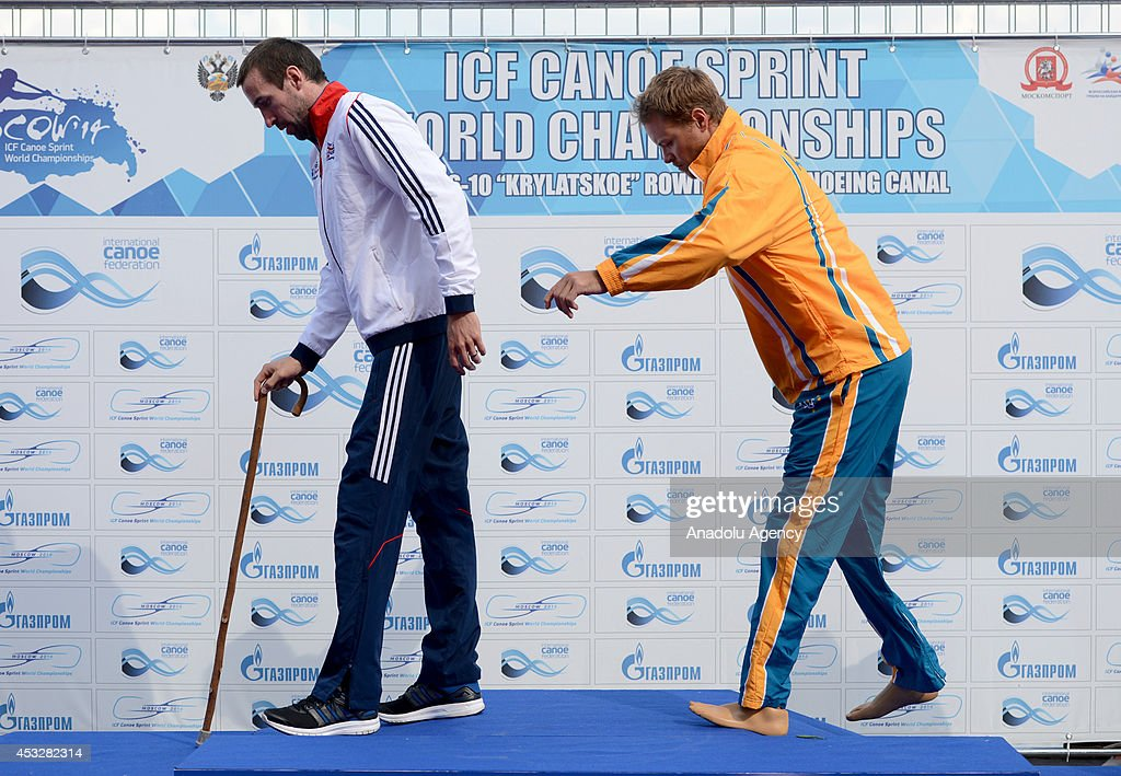 Gold medalist Curtis McGrath (R) of Australia and silver medalist Jonathan Young (L) of Great Britain arrive for the medal ceremony for the men's V1 (TA) 200m final of the 2014 ICF Canoe Sprint World hampionships in Moscow, Russia on August 6, 2014.