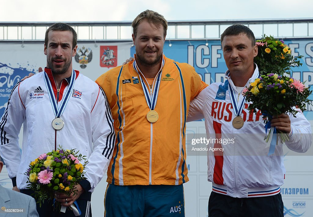 Gold medalist Curtis McGrath (C) of Australia, silver medalist Jonathan Young (L) of Great Britain and bronze medalist Viktor Potanin (R) of Russia pose with their medals after the men's V1 (TA) 200m final of the 2014 ICF Canoe Sprint World hampionships in Moscow, Russia on August 6, 2014.