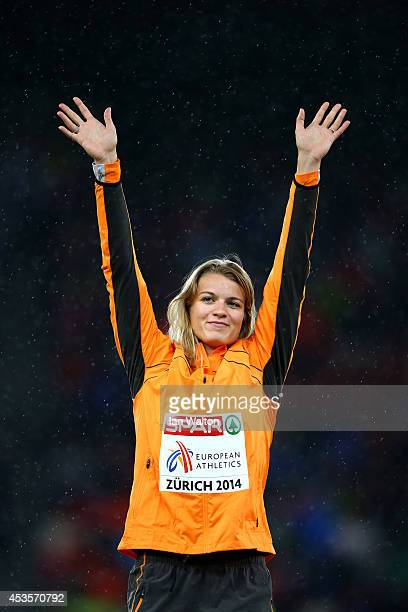 Gold medalist Dafne Schippers of the Netherlands celebrates on the podium during the medal ceremony after the Women's 100 metres final during day two...