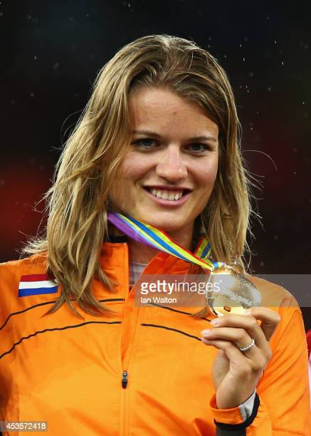 Gold medalist Dafne Schippers of the Netherlands pose on the podium during the medal ceremony after the Women's 100 metres final during day two of...