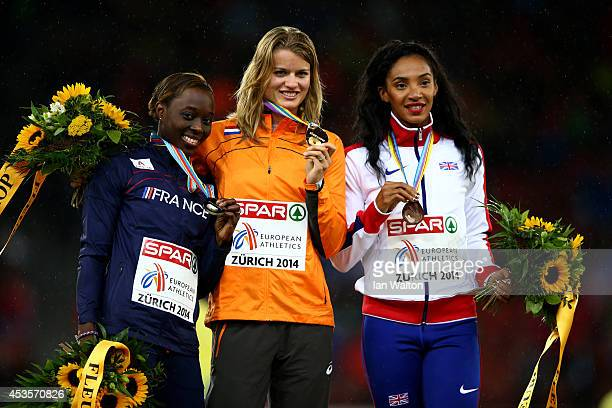 Gold medalist Dafne Schippers of the Netherlands poses next to silver medalist Myriam Soumare of France and bronze medalist Ashleigh Nelson of Great...