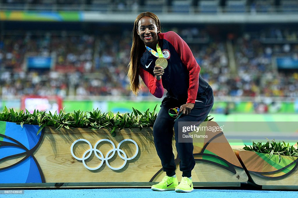 Gold medalist Dalilah Muhammad of the United States poses on the podium during the medal ceremony for the Women's 400m Hurdles on Day 14 of the Rio...
