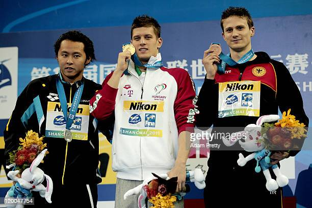 Gold medalist Daniel Gyurta of Hungary poses with silver medalist Kosuke Kitajima of Japan and bronze medalist Christian Vom Lehn of Germany after...