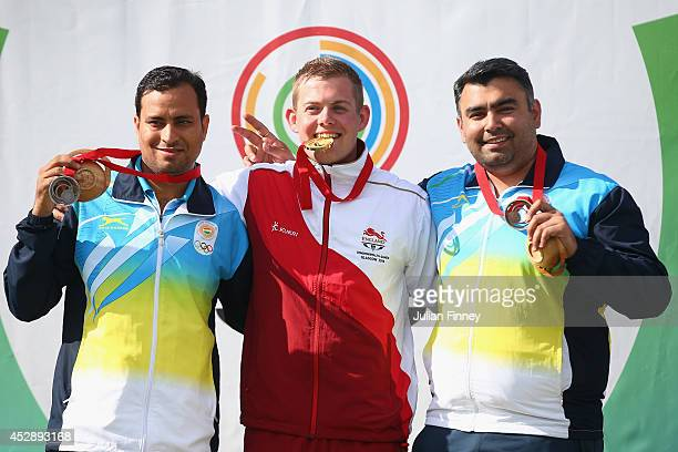 Gold medalist Daniel Rivers of England Silver medalist Sanjeev Rajput of India and Bronze medalist Gagan Narang of India after the 50m Rifle 3...