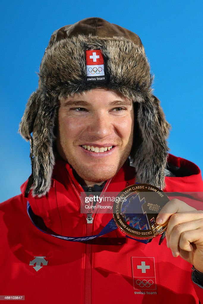Gold medalist <a gi-track='captionPersonalityLinkClicked' href=/galleries/search?phrase=Dario+Cologna&family=editorial&specificpeople=4779620 ng-click='$event.stopPropagation()'>Dario Cologna</a> of Switzerland celebrates during the medal ceremony for the Men's Skiathlon 15 km Classic + 15 km Free on day 2 of the Sochi 2014 Winter Olympics at Medals Plaza on February 9, 2014 in Sochi, Russia.