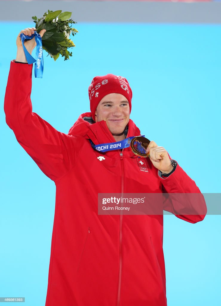Gold medalist <a gi-track='captionPersonalityLinkClicked' href=/galleries/search?phrase=Dario+Cologna&family=editorial&specificpeople=4779620 ng-click='$event.stopPropagation()'>Dario Cologna</a> of Switzerland celebrates during the medal ceremony for the Cross Country Men's 15km Classic event on day 7 of the Sochi 2014 Winter Olympics at Medals Plaza on February 14, 2014 in Sochi, Russia.