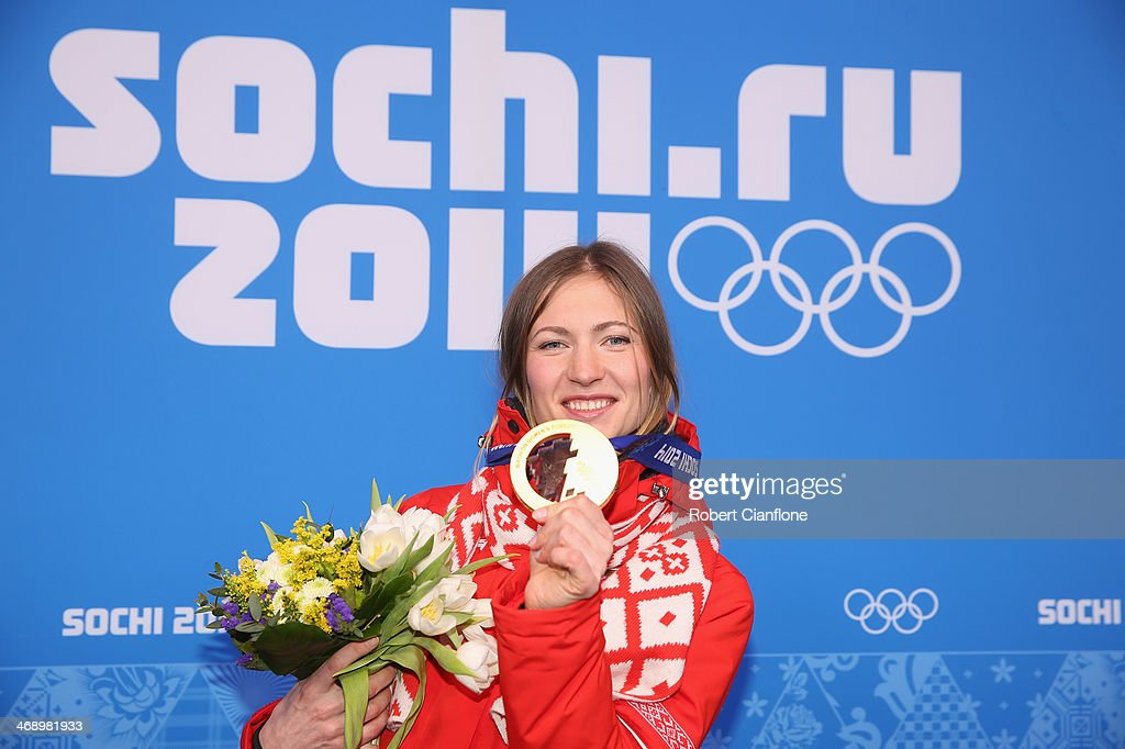 Gold medalist <a gi-track='captionPersonalityLinkClicked' href=/galleries/search?phrase=Darya+Domracheva&family=editorial&specificpeople=4105955 ng-click='$event.stopPropagation()'>Darya Domracheva</a> of Belarus celebrates during the medal ceremony for the Women's 10 km Pursuit on day five of the Sochi 2014 Winter Olympics at Medals Plaza on February 12, 2014 in Sochi, Russia.
